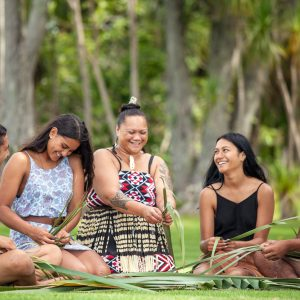 A group of women weave Harakeke or flax at the Waitangi Treaty grounds