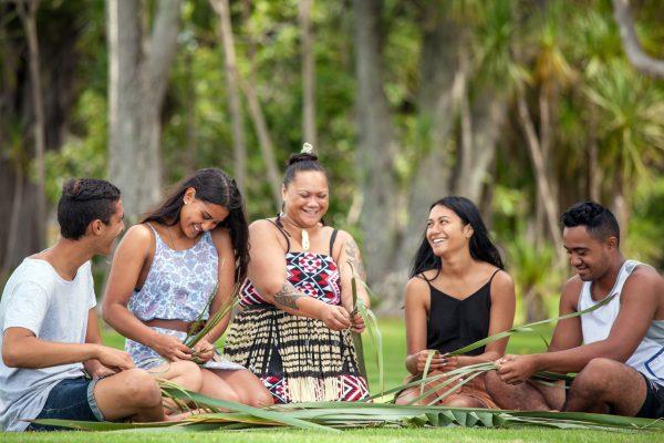 A group of women weave Harakeke or flax at the Waitangi Treaty grounds