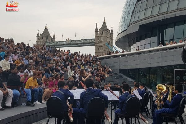 Band playing with a view of Tower Bridge