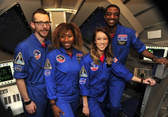 4 teachers in thier Nasa flight suits at Adult Space Academy