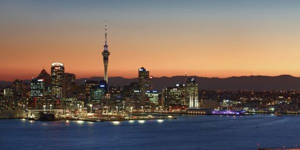 Auckland skyline with water at sunset