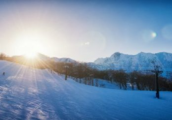 Sunset over a Hakuba ski resort slope