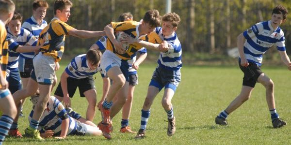 An attempted tackle between two school boys' rugby teams at the Welsh Osprey's Challenge event