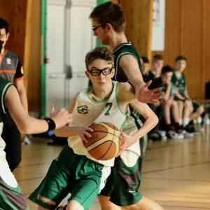 Boys' teams playing basketball