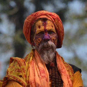 nepalese man with traditional face paint